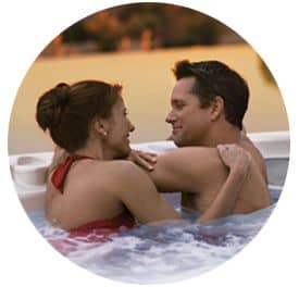 Couple enjoying their repaired hot tub in San Diego